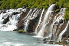Hraunfossar vattenfall, Island Royaltyfri Foto