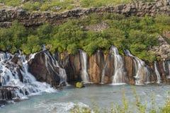 Hraunfossar vattenfall, västra Island arkivfoton