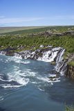 Hraunfossar waterfall emerging from under Hallmundarhraun lava f Royalty Free Stock Photography