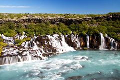 Hraunfossar waterfall, Iceland. Hraunfossar waterfall with river, Iceland, Europe royalty free stock image