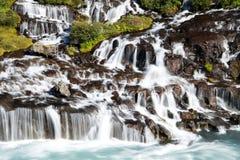 Hraunfossar waterfall, Iceland. Hraunfossar panoramic waterfall, Iceland, Europe stock image