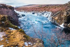 Hraunfossar waterfall, Iceland. Autumn landscape. Hraunfossar, a waterfall formed by rivulets streaming over Hallmundarhraun, a lava field from volcano lying Royalty Free Stock Images