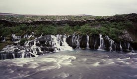 Hraunfossar waterfall. In Iceland seen from river shore Royalty Free Stock Photography