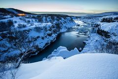 Hraunfossar waterfall in winter, Iceland. Hraunfossar waterfall in winter, long exposure. One of the most popular waterfall in Iceland, Europe Stock Photography