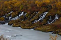 Hraunfossardalingen, IJsland Stock Foto