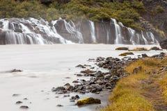 Hraunfossarwaterval, IJsland Stock Foto