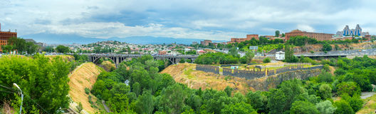 The Hrazdan River's gorge in Yerevan. Panorama of the Hrazdan gorge in Yerevan with the Victory bridge and cloudy Ararat Mount on the background, Armenia Stock Photos