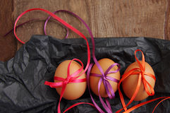 Тhree Easter eggs with bright color tapes Stock Photos