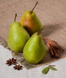 Tree green pear rustic style cinammon anis fruit fresh burlap. Three green pear rustic style cinammon anis fruit fresh flax burlap royalty free stock photography