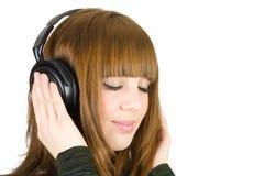 Hörende Musik des Mädchens Stockbild