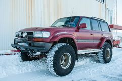 Icelandic modified Toyota Land Cruiser on big wheels in snow. Hrisey Iceland - December 29. 2017: Icelandic modified Toyota Land Cruiser on big wheels in snow Stock Photography