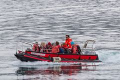 Passengers from cruise ship Fram entering port of Hrisey in small boat. Hrisey Iceland - June 8. 2018: Passengers from cruise ship Fram entering port of Hrisey stock photography