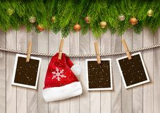 Сhristmas background with photos and a Santa hat. Royalty Free Stock Photos
