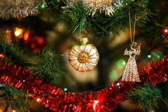 Сhristmas ball in shape of sunflower on Christmas tree. Stock Images