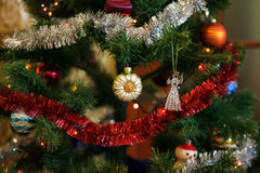 Сhristmas ball in shape of sunflower on Christmas tree. Royalty Free Stock Photo