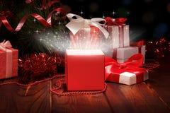 �hristmas box and Christmas tinsel Royalty Free Stock Photography
