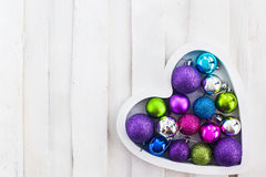 Сhristmas card with wooden heart, balls, decoration and fir-tre Stock Photography