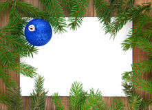 �hristmas decoration. With greeting card isolated on wooden background Royalty Free Stock Photo