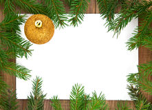 �hristmas decoration. With greeting card isolated on wooden background Royalty Free Stock Photography