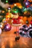 Сhristmas deer stuffed toy on Christmas tree. Stock Photos