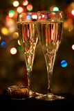 Сhristmas tree, two champagne glasses and cork Stock Image
