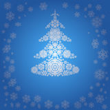 Сhristmas tree from white snowflakes. Blue Christmas background Stock Photography