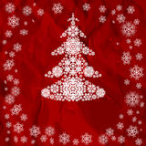 Сhristmas tree from white snowflakes. Red Christmas background. Stock Image