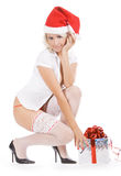 Hristmas woman in santa hat and white stockings Royalty Free Stock Photos