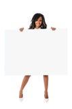 härlig blank holdingteckenkvinna Arkivfoton