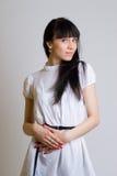 Härlig flicka i white Arkivbild