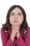 Härlig flicka som ber och ser upp Arkivbilder