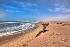 Härlig kust i smörgåshamnområde, Namibia Arkivbild