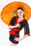 Härlig kvinna i japansk kimono Royaltyfria Foton