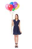 Härlig kvinna med färgrika ballonger Arkivbilder