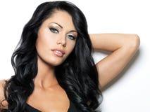 Härlig kvinna med långt hår för skönhet Fotografering för Bildbyråer