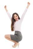 Härlig kvinna som huka sig ned med lyftta armar Royaltyfri Fotografi