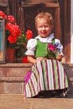 Härlig liten flicka i en dirndl Royaltyfri Fotografi