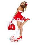 Härlig sexig flicka som slitage Santa Claus kläder Royaltyfri Bild