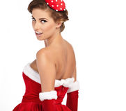 Härlig sexig kvinna som bär Santa Claus kläder Arkivfoton