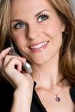 härlig telefonkvinna Arkivbild