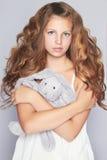 Härlig tonårig flicka med leksaken Royaltyfria Bilder