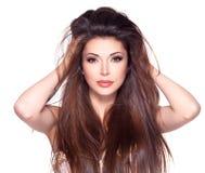 Härlig vit nätt kvinna med långt rakt hår Fotografering för Bildbyråer