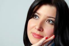 Härliga brunn-ansad kvinnas framsida Fotografering för Bildbyråer