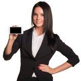 Härliga kvinnor i dräktvisning ilar telefonen Arkivfoto