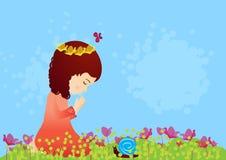 Härligt be för liten flicka Arkivfoto