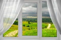 härligt siktsfönster Arkivbilder