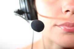 hörlurar med mikrofonkvinna Royaltyfria Bilder