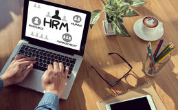 HRM Human Resource Management  Strategy Planning Working HRM man. Man hand on table Business, coffee, Split tone Royalty Free Stock Photos