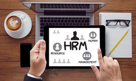 HRM Human Resource Management  Strategy Planning Working HRM man. On the tablet pc screen held by businessman hands - online, top view Royalty Free Stock Image
