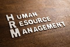 HRM Wood Letters. HRM Human Resource Management text by wood letters on wood texture Royalty Free Stock Photography